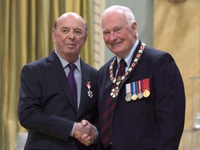 Governor General David Johnston invests Bob Cole, from St.John's, Nfld. as a Member of the Order of Canada during a ceremony at Rideau Hall Friday September 23, 2016 in Ottawa. Veteran hockey broadcaster Bob Cole isn't calling NHL playoff games for the first time in his career, but he's still open to returning to the broadcast booth next season.THE CANADIAN PRESS/Adrian Wyld