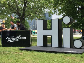 Representatives for Tweed Inc., a licenced producer of cannabis, mingle with concertgoers at the Field Trip music festival in Toronto on Sunday, June 3, 2018.