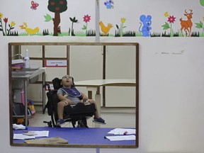 In this May 4, 2018 photo, Jose Wesley Campos, who was born with the Zika-caused microcephaly birth defect, waits for his therapy session at the Disabled Child Assistance Association, in Recife, Brazil. Despite the progress, the developmental challenges for Jose are gargantuan. He recently had hip surgery, which doctors have found necessary for many children with microcephaly as they become toddlers.
