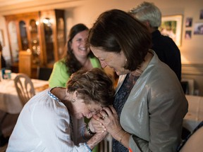 Rose Lipszyc, left, and Janina Zak-Krasucki embracing at a coming together of families at Rose's home, Toronto, Ont., June 9, 2018.