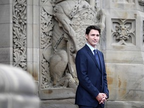 Prime Minister Justin Trudeau waits for the arrival of President of France Emmanuel Macron on Parliament Hill for a visit in Ottawa on Wednesday, June 6, 2018.
