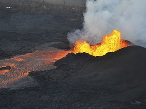 This photo provided by the U.S. Geological Survey shows lava fountaining at a fissure near Pahoa on the island of Hawaii Tuesday, June 5, 2018. Lava from Hawaii's Kilauea volcano destroyed hundreds more homes overnight, overtaking two oceanfront communities where residents were advised to evacuate last week, officials said Tuesday.  (U.S. Geological Survey via AP)