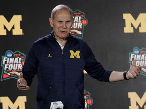 FILE - In this March 29, 2018, file photo, Michigan head coach John Beilein answers questions after a practice session for the Final Four NCAA college basketball tournament, in San Antonio. Beilein is staying at Michigan. He announced on Twitter on Wednesday, June 6, 2018, that he's excited about coaching the Wolverines next season and in the years to come. The 65-year-old Beilein has coached at Michigan for 11 seasons. He has led the Wolverines to two Final Fours, losing in the national title game this year and in 2013. Beilein has won a pair of Big Ten championships and two Big Ten Tournament titles. A person with knowledge of the situation told The Associated Press earlier this month Beilein interviewed with the Detroit Pistons about their coaching vacancy.