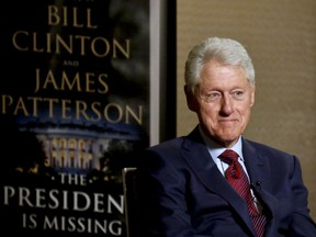 """In this Monday, May 21, 2018, photo, former President Bill Clinton listens during an interview about a novel he wrote with James Patterson, """"The President is Missing,""""  in New York."""