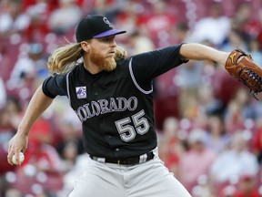 Colorado Rockies starting pitcher Jon Gray throws during the first inning of the team's baseball game against the Cincinnati Reds, Wednesday, June 6, 2018, in Cincinnati.
