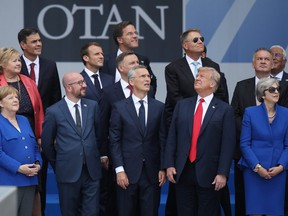 From L to R, first row, German Chancellor Angela Merkel, Belgian Prime Minister Charles Michel, NATO Secretary General Jens Stoltenberg, U.S. President Donald Trump and British Prime Minister Theresa May attend the opening ceremony at the 2018 NATO Summit at NATO headquarters on July 11, 2018 in Brussels, Belgium.