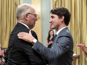 Bill Blair is congratulated by Prime Minister Justin Trudeau after being sworn in as Minister of Border Security and Organized Crime Reduction on July 18, 2018.