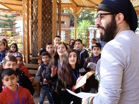 An activist leads a camp on religious dialogue for children and their mothers in Latakia, Syria, in January 2016. The camp was funded by Canada's Office of Religious Freedom, which the Liberal government closed two months later.
