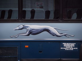The Greyhound logo is seen on one of the company's buses, in Vancouver, on Monday July 9, 2018. Prime Minister Justin Trudeau says he's asked Transport Minister Marc Garneau to find solutions in Greyhound Canada's absence,