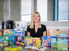 Charlene Elliott, of the University of Calgary, poses with an array of gluten-free packaged foods marketed for children in an undated handout photo.