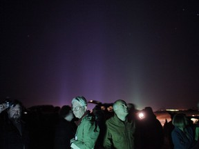 A group of attendees gather in a desert area for UFO sightings at the Annual International UFO Congress Convention Convention & Film Festival in Laughlin, Nev., on February 26, 2009.