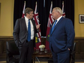 Ontario Premier Doug Ford and Toronto Mayor John Tory meet inside the Premier's office at Queen's Park in Toronto on Monday, July 9, 2018. A published report suggests the Ontario government is poised to reduce Toronto city council to just over half its current size.