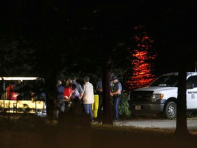 Rescue crews work at the scene of a deadly boat accident at Table Rock Lake in Branson, Mo., Thursday, July 19, 2018. A sheriff in Missouri said a tourist boat has apparently capsized on the lake, leaving several people dead and several others hospitalized.