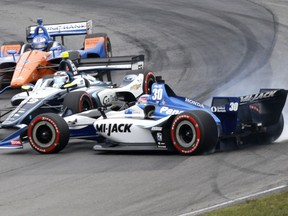 Takuma Sato (30) spins in front of Max Chilton (59) and Scott Dixon (9) in the IndyCar Series auto race, Sunday, July 29, 2018, at Mid-Ohio Sports Car Course in Lexington, OH. Sato spun and continued in the race.