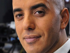 In this photo dated Nov. 22, 2010, notorious French criminal Redoine Faid poses prior to an interview with French all-news TV channel, LCI, as he was promoting his book, in Boulogne-Billancourt, outside Paris, France.  Faid serving 25 years for murder made an audacious escape from prison Sunday after a helicopter carrying several heavily armed commandos landed in a courtyard, freed him from a visiting room and carried him away.