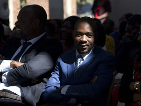 Zimbabwean opposition challenger Nelson Chamisa participates in a Sunday church service in Harare, Zimbabwe, Sunday July 29, 2018. Zimbabwe votes Monday in an election that could, if deemed credible, tilt the country toward recovery after years of economic collapse and repression under former leader Robert Mugabe.