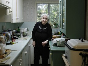 Anna Stady stands in her kitchen in Union Bay, B.C. on Thursday Aug. 2, 2018. The 95-year-old Vancouver Island woman says she shooed a black bear out of her home twice in one day last week.