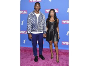 Victor Cruz, left, and Karrueche Tran arrive at the MTV Video Music Awards at Radio City Music Hall on Monday, Aug. 20, 2018, in New York.