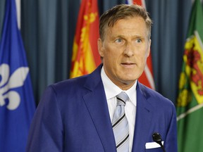 Quebec MP Maxime Bernier speaks at a press conference in Ottawa on Thursday, Aug. 23, 2018.