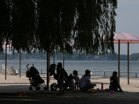 People cool down at Toronto's Sugar Beach during a heat warning.