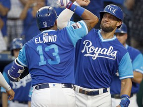 Kansas City Royals' Salvador Perez (13) celebrates with Alex Gordon after hitting a three-run home run during the first inning of a baseball game against the Cleveland Indians on Friday, Aug. 24, 2018, in Kansas City, Mo.