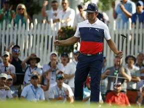 Gary Woodland reacts to a birdie on the 16th hole during the first round of the PGA Championship on Thursday at Bellerive Country Club in St. Louis.