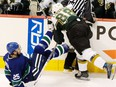 In this April 23, 2007 file photo, Dallas Stars forward Eric Lindros (right) hits Vancouver Canucks forward Josh Green.
