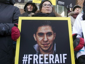 Ensaf Haidar, wife of Saudi blogger Raif Badawi, takes part in a rally for his freedom in Montreal on January 13, 2015. Saudi Arabia said Sunday it was ordering Canada's ambassador to leave the country and freezing all new trade and investment transactions with Canada in a spat over human rights.