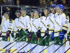 The Humboldt Broncos take part in a ceremony honouring late head coach and GM Darcy Haugan before an exhibition game against the Whitecourt Wolverines in Peace River, Alta., Haugan's hometown, on Sept. 1.