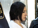 Terri-Lynne McClintic, convicted in the death of eight-year-old Tori Stafford, is escorted into court on Sept. 12, 2012 for her trial in an assault on another inmate.