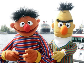 "In this May 9, 2006, file photo, Ernie and Bert of ""Sesame Street"" pose in front of the Queen Mary II in the harbour of Hamburg, Germany."