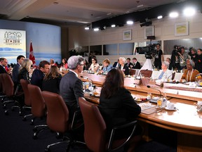 Canadian Prime Minister Justin Trudeau speaks as the seat of US President Donald Trump sits empty during the Gender Equality Advisory Council working breakfast on the second day of the G7 Summit on June 9, 2018 in Quebec City, Canada.