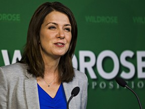 Danielle Smith gives a statement regarding two Wildrose MLAs who crossed the floor to the Progressive Conservative Party at the Legislature Annex in Edmonton, Alta., on Monday, Nov. 24, 2014.