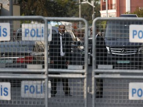 Security personnel guarding Saudi Arabia's consulate are seen behind barriers blocking the road leading to the diplomatic mission, in Istanbul, Monday, Oct. 22, 2018. Saudi Crown Prince Mohammed bin Salman called the son of Jamal Khashoggi, the kingdom announced early Monday, to express condolences for the death of the journalist killed at the Saudi Consulate in Istanbul by officials that allegedly included a member of the royal's entourage.