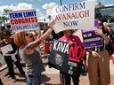 Anti- and pro-Brett Kavanaugh protesters face off outside the office of Republican Sen. Jeff Flake on Oct. 4, 2018, in Phoenix.