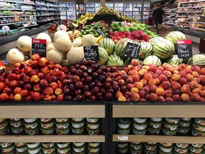 In this June 14, 2018, file photo, nectarines, plums, mangos and peaches are marked at a fruit stand in a grocery store in Aventura, Fla. The world's agriculture producers are not growing enough fruits and vegetables to feed the global population a healthy diet, according to new Canadian-led research.THE CANADIAN PRESS/AP/Brynn Anderson, File