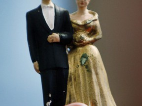 A wedding cake topper is shown in a Nov.29, 2011 file photo. A wedding mishap landed in a Nova Scotia small claims court and a judge ordered a rental company to pay.