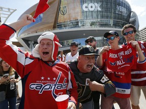 FILE - In this May 30, 2018, file photo, Washington Capitals and Vegas Golden Knights fans cheer outside T-Mobile Arena prior to Game 2 of the NHL hockey Stanley Cup Finals, in Las Vegas. Hockey fans have often criticized NBC's coverage for not showing more of the NHL's young stars and the up-and-coming teams. That changes when the season opens on Wednesday, Oct. 3, as the network goes with a new approach.