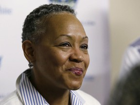 """FILE - In this May 21, 2016, file photo, WNBA President Lisa Borders smiles as she speaks to reporters before a WNBA basketball game between the San Antonio Stars and the Dallas Wings in Arlington, Texas. TIME'S UP has named Borders as its first president and CEO. In a statement Tuesday, Oct. 2, 2018, the organization said Borders will lead the organization's efforts to """"ensure equal opportunity and protection for all working women."""""""