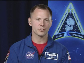In this frame from video from NASA TV, NASA astronaut Nick Hague, who survived the Oct. 11, 2018, failed launch and emergency landing, speaks Tuesday, Oct. 16, 2018, from the NASA Johnson Space Center in Houston.