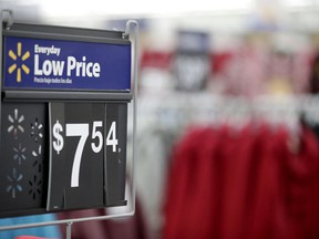 FILE- This Nov. 9, 2017, file photo shows items on display ahead of the holiday shopping season at a Walmart store in Secaucus, N.J. Walmart says it's acquiring an online plus-size fashion brand called Eloquii Design Inc., continuing its buying spree of niche brands as tries to compete better with online leader Amazon.com