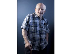 This Oct. 8, 2018 photo shows Ed Asner posing for a portrait at Golden Apple Comics in Los Angeles to promote an internet comic-art auction that will be held Wednesday, Oct 17, to raise funds for The Ed Asner Family Center.
