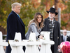 U.S. President Donald Trump and First Lady Melania Trump, alongside Rabbi Jeffrey Myers, place stones and flowers on a memorial as they pay their respects at the Tree of Life Synagogue following last weekend's shooting in Pittsburgh, Pennsylvania, Oct. 30, 2018.