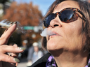 A woman smokes marijuana in Vancouver on Oct. 17, 2018 — the first day it was legalized.
