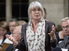 Labour Minister Patty Hajdu rises during question period in the House of Commons on Parliament Hill.