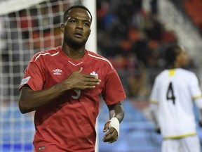Canada's Cyle Larin celebrates scoring against Dominica during second half Concacaf Nations League qualifier soccer action in Toronto on Tuesday, October 16, 2018.