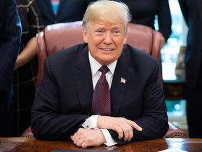 Donald Trump speaks after signing the Cybersecurity and Infrastructure Security Agency Act,  in the Oval Office of the White House in Washington, DC, November 16, 2018.