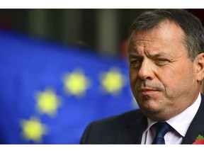 Leave campaigner and businessman Arron Banks, centre,  speaks to the media outside BBC Broadcasting House in London, after appearing on the Andrew Marr show, in London, Sunday, Nov. 4, 2018. Britain's National Crime Agency is investigating a main financial backer of the campaign to get Britain out of the European Union over suspected illegal funding during the country's EU membership referendum, authorities said Thursday.