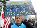 Uighurs demonstrate outside the European headquarters of the United Nations, in Geneva, Switzerland, during a review of China by the UN Human Rights Council, on Nov. 6, 2018.