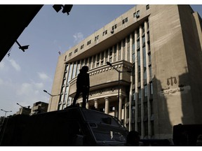 In this Nov. 8, 2017 file photo, Egyptian security officers guard a courthouse, in Cairo. Egypt has created a new high-powered human rights watchdog agency, but its primary mission isn't to protect Egyptians from violations. Instead, the body is primarily aimed at protecting the government from allegations of rights abuses, especially those made by international groups. The new body reflects an attitude of the state under President Abdel-Fattah el-Sissi that sees accusations of human rights violations to be intended to undermine the government and cause instability.